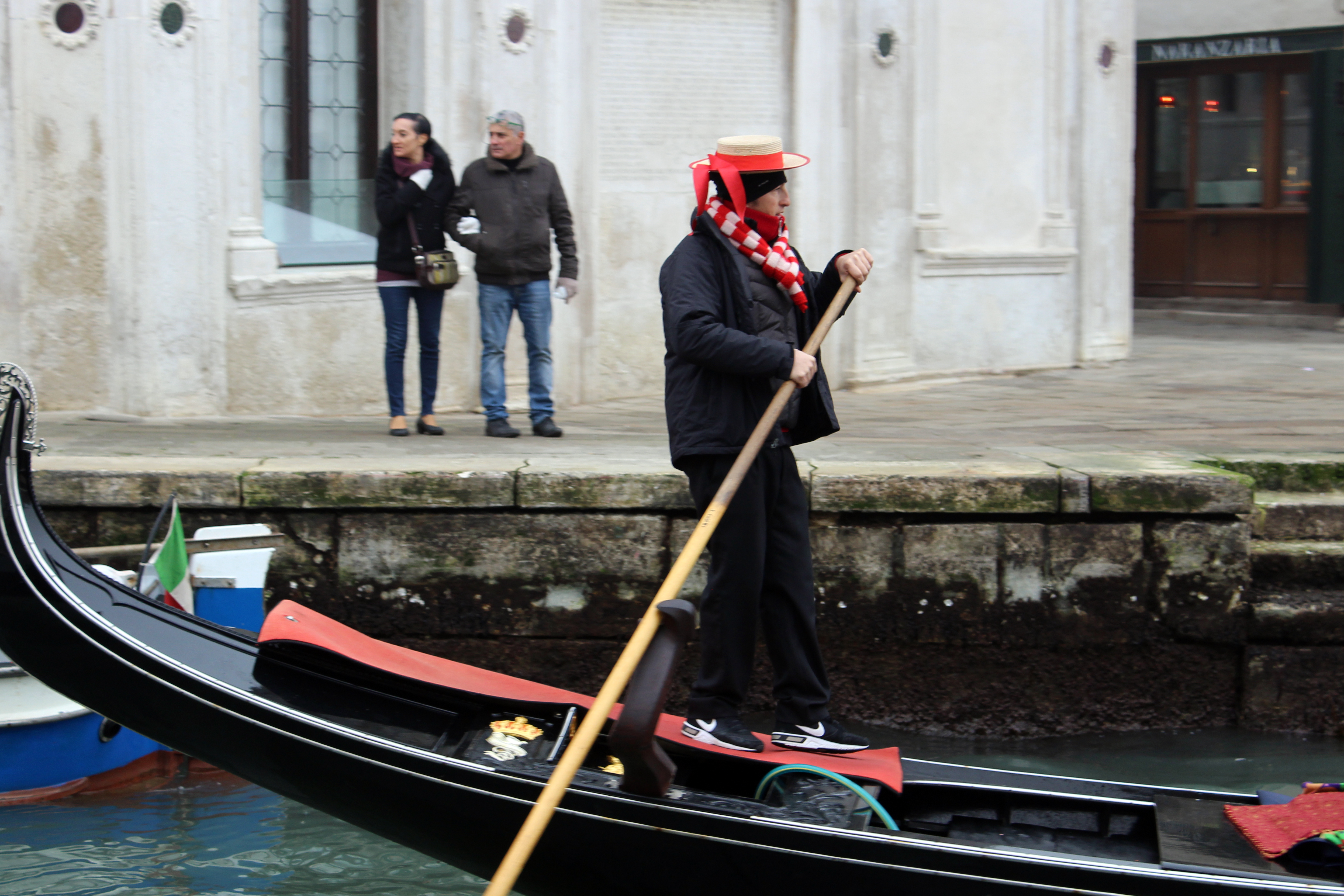 Man on Gondola on the Grand Canal in Venice Italy