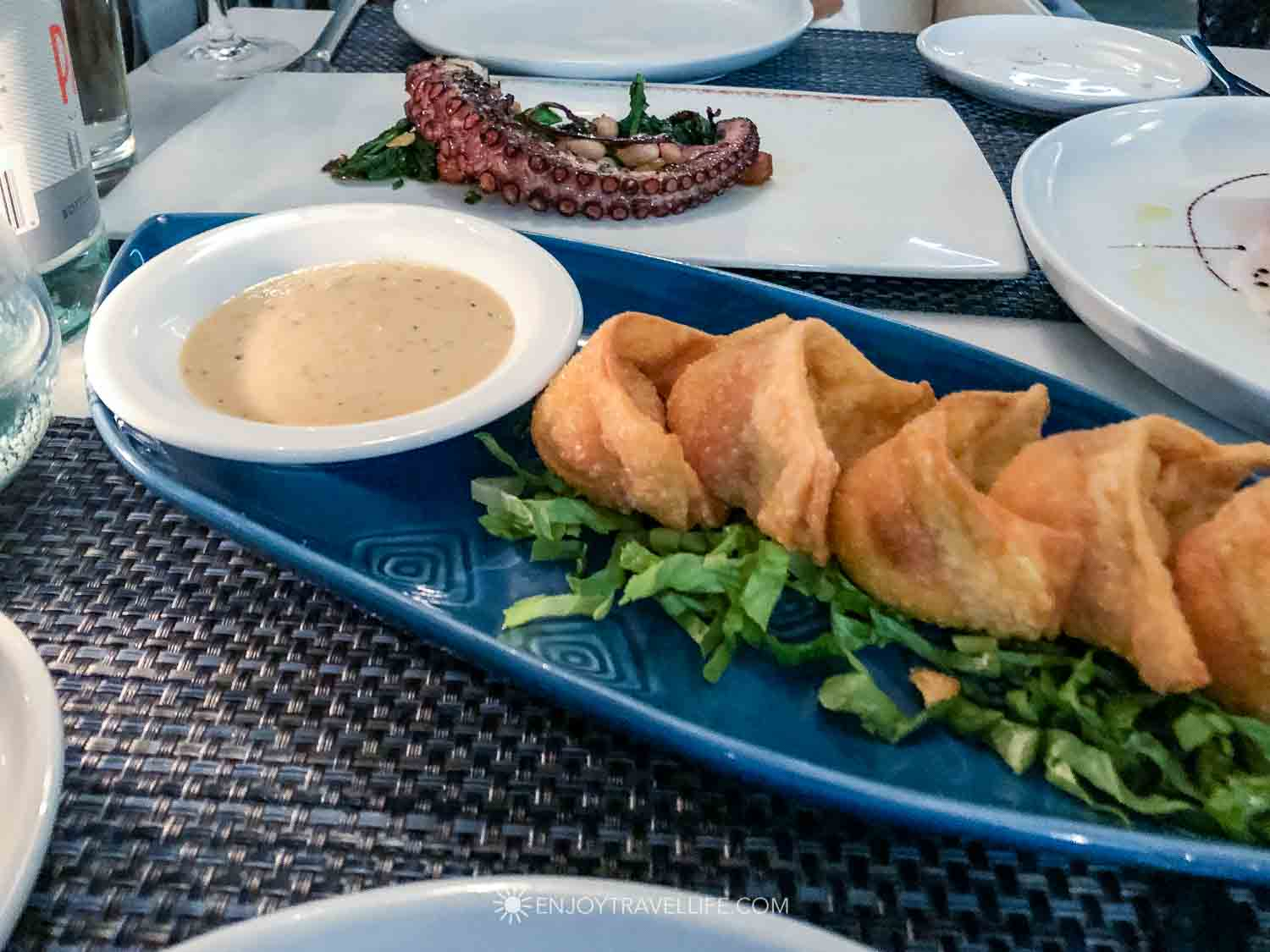 Fried rangoons stuffed with crab and lobster with a spicy dipping sauce