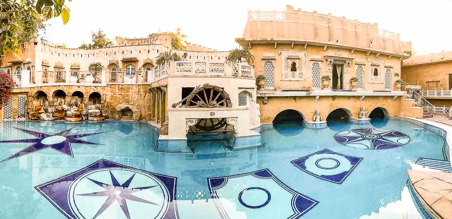 Large pool at a romantic palace hotel in India
