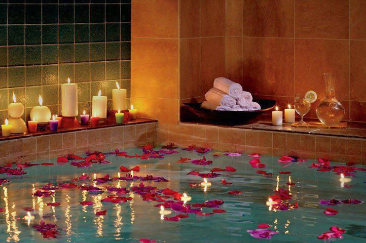 rose petals float in pool - hotel romance package