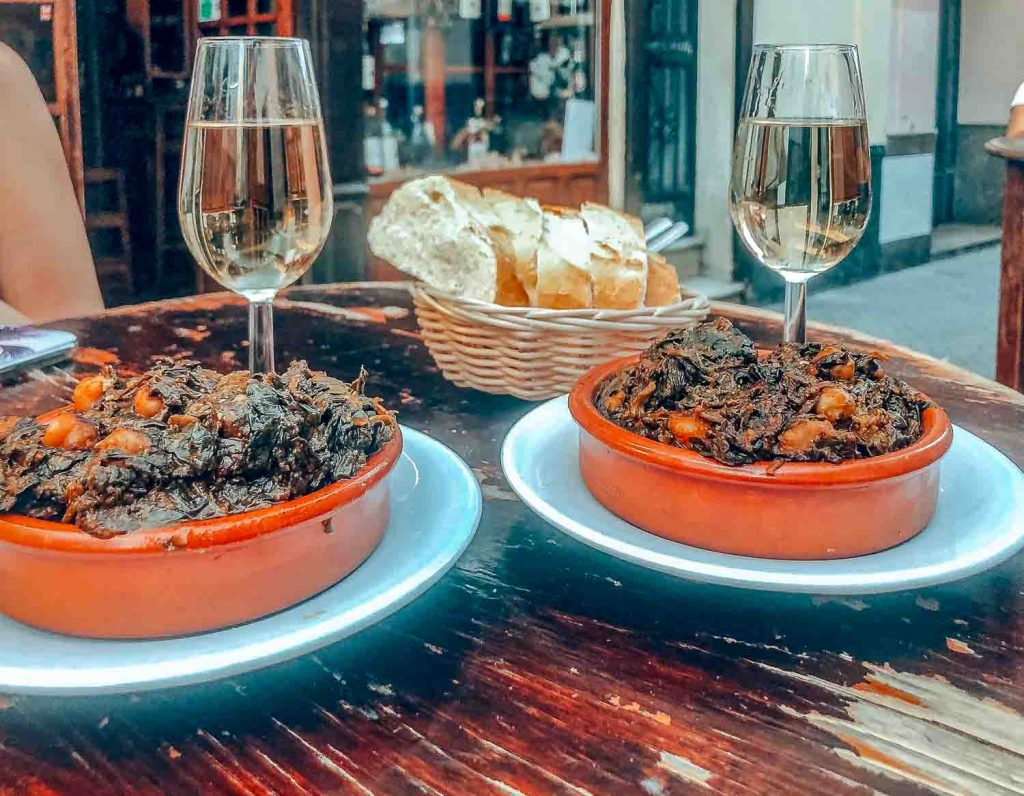 A traditional dish of Seville Spain: Espinacas con Garbanzos, or spinach with chickpea stew | Food Tourism