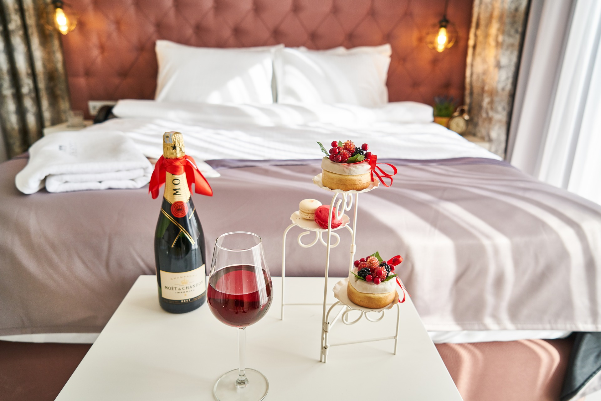 romantic hotel packages - wine and pastry in hotel room