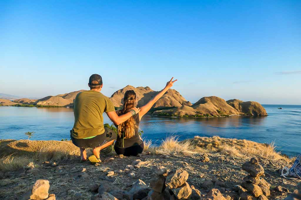 A couple looks at a rocky island on a wildlife vacation in Komodo National Park