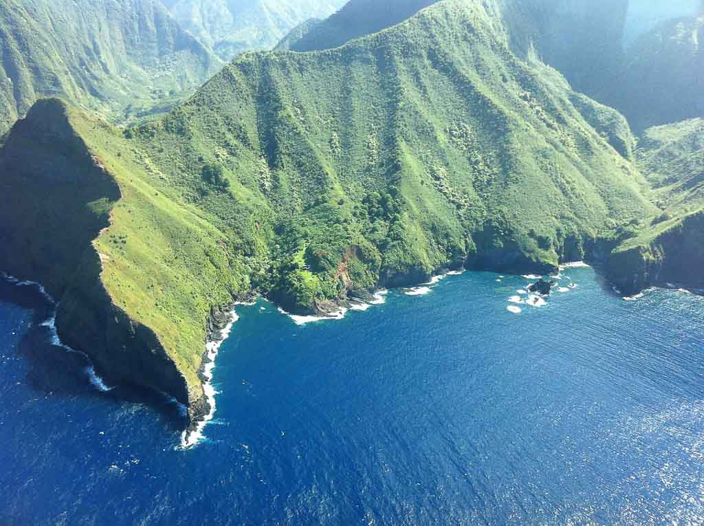 An aerial view of the mountain range on Molokai Island and the surrounding water [Hawaii]