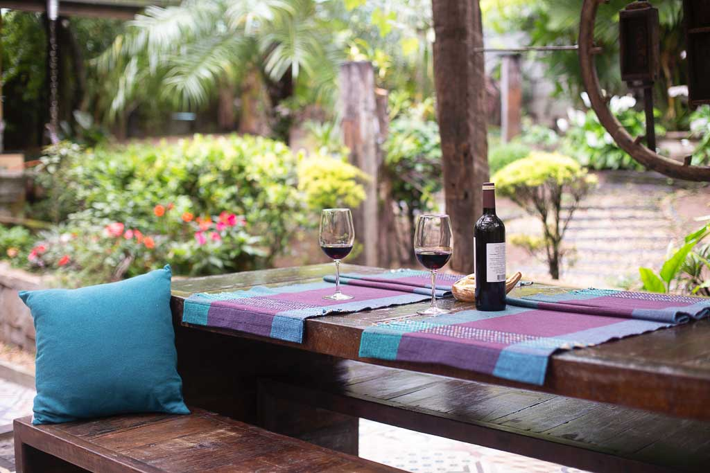 Picnic table in garden with colorful table cloth