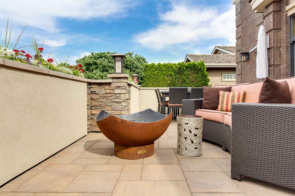 Luxury Outdoor Living Space: Couch with fire bowl on patio