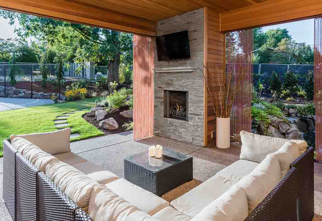 Luxury Outdoor Living Space: Outdoor living room with fireplace and television