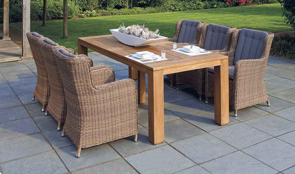 Rattan chairs and wood table for outdoor dining