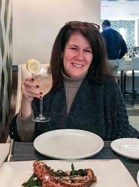 Travel Blogger Jackie Gately (Enjoy Travel Life) enjoys a beverage and octopus dinner at il Molo in Boston's North End.
