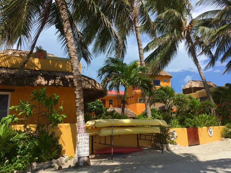 Belize is one of the best places for American expats / shown, colorful houses and kayaks for rent