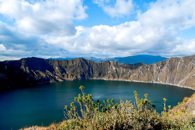 Best places for American expats: Ecuador. Shown, jewel-toned water fills a large crater.