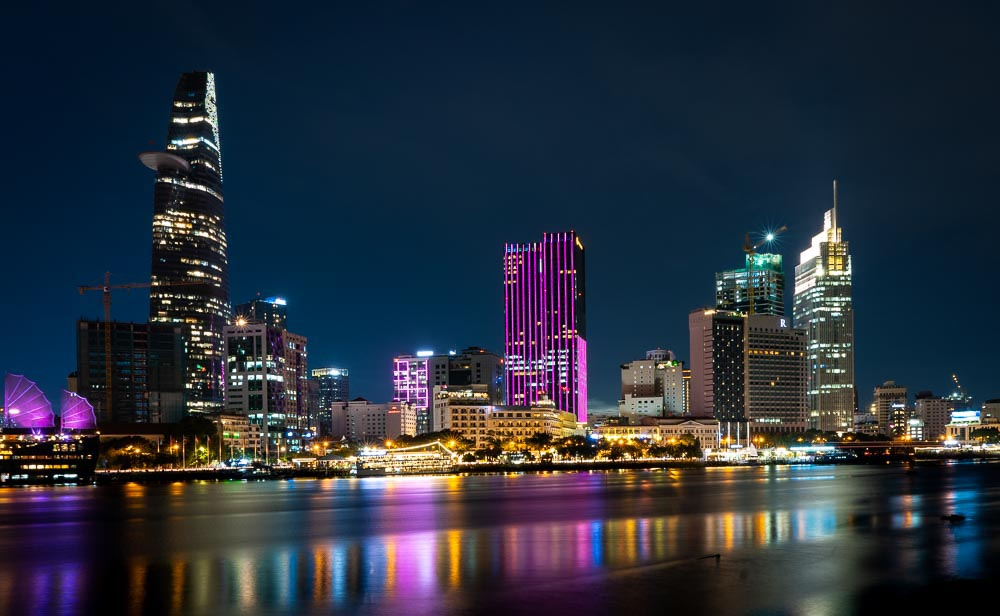 Ho Chi Minh City, Vietnam's colorful city skyline reflects in the water. (best places for US expats)