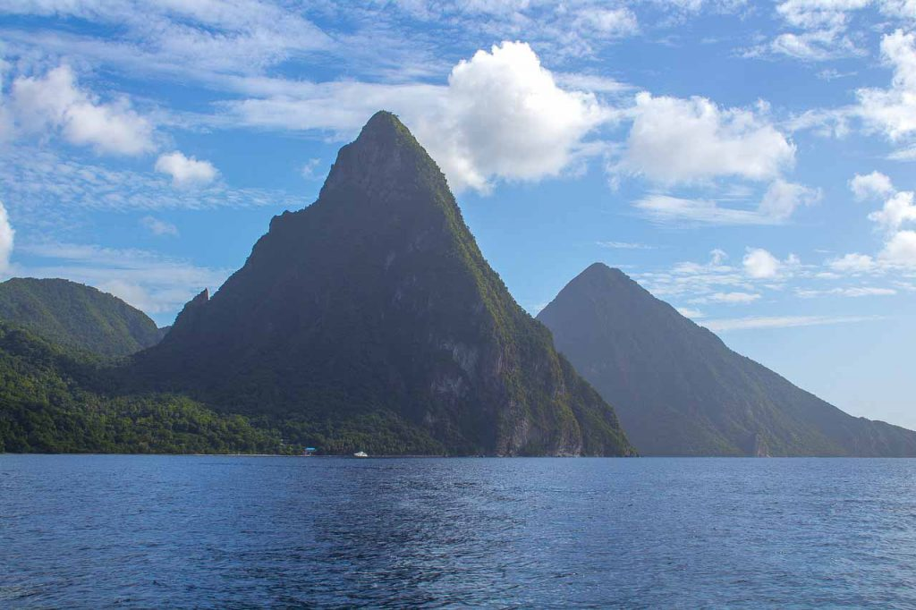 Soaring twin mountains arise from the water in St. Lucia, Caribbean vacation for warm winter getaway