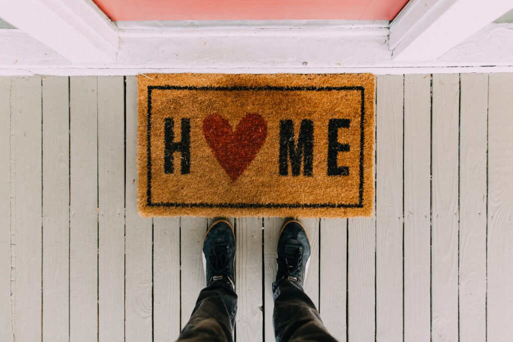 welcome home mat on porch