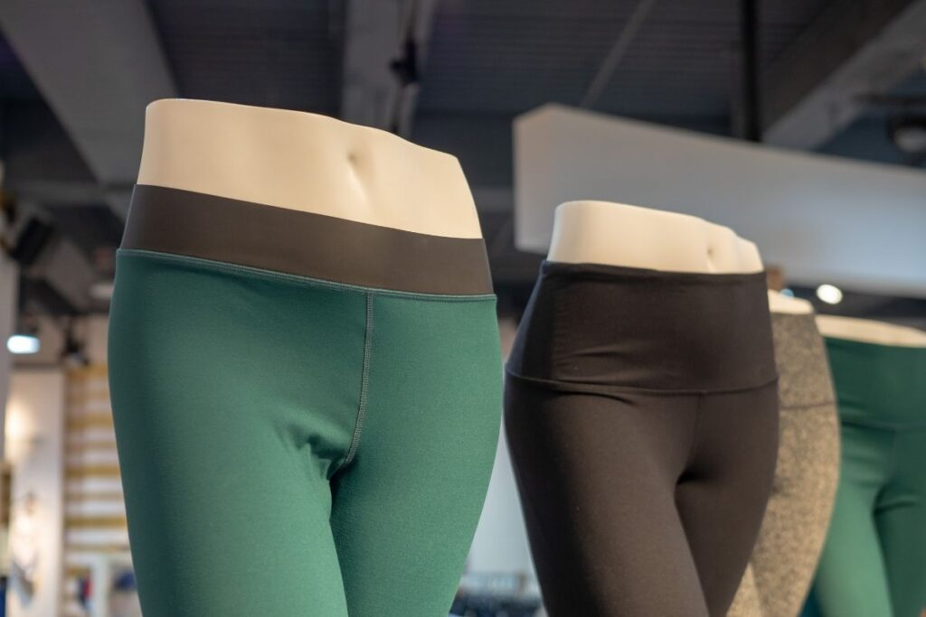 mannequins in green and brown yoga pants