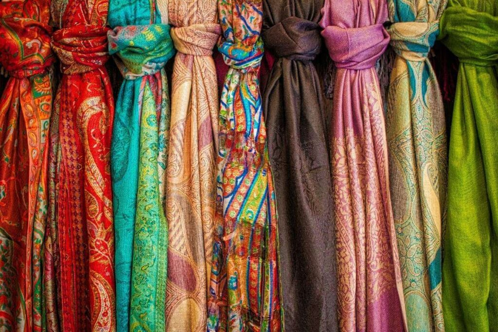 a row of colorful print scarves