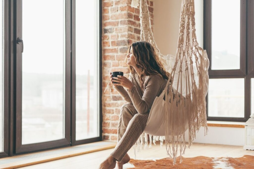 woman drinking tea alone in apartment