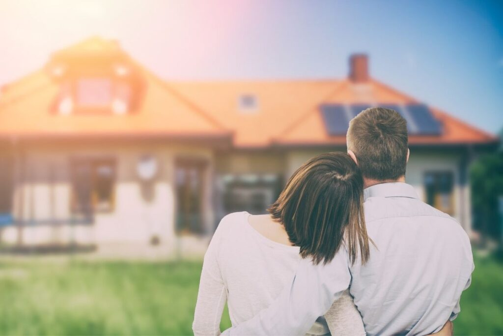 couple hugs at dream home