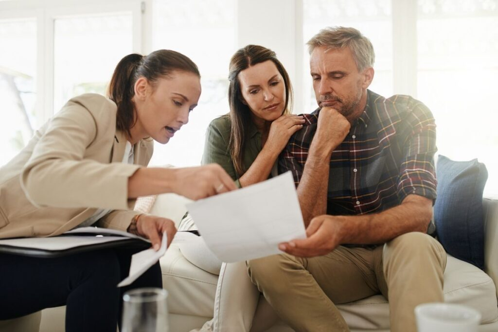 security professional consults with couple